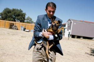 Ryan Clinton holds a rescued dog, photo from the Christian Science Monitor.